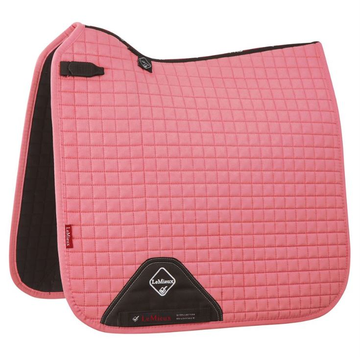 A blush colored Lemieux ProSport dressage saddle pad with black lining.
