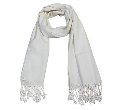 A cream colored long scarf looped at the top with fringe at each end that would make a good holiday gift.