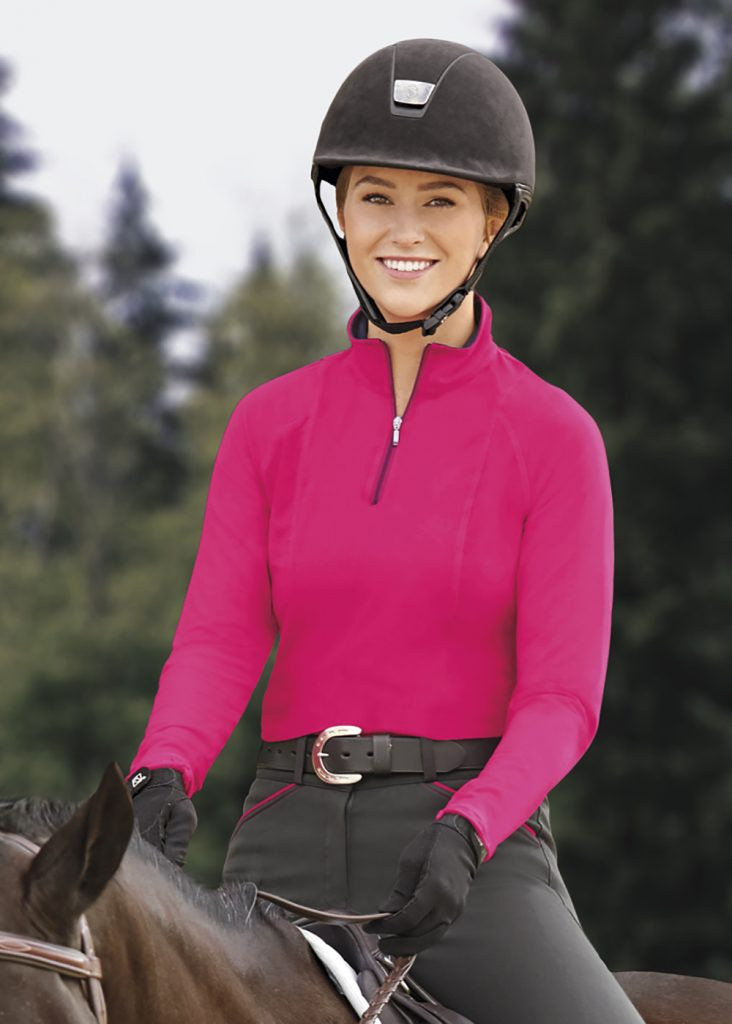 Woman riding a bay horse wearing a hot pink quarter-zip top from Dover Saddlery's Spring Brights performance wear collection.