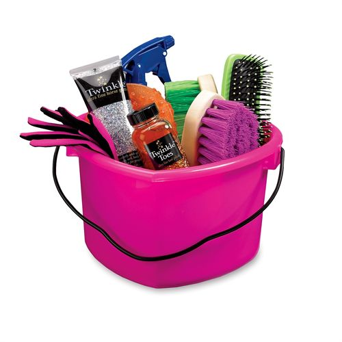 Pink heart-shaped pail filled with horse-themed gifts.
