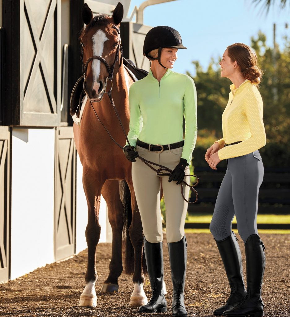 Two riders are sporting Dover Saddlery CoolBlast Long Sleeve Shirts while spending time at the barn.